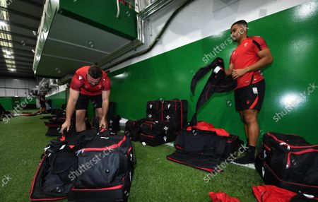 Owen Lane and Ben Thomas look through their kit bags during the Wales squads first day of camp.