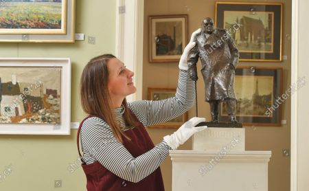 Lucy Darlington from Dreweatts with the Churchill maquette.   A rare maquette of Sir Winston Churchill's famous statue in Parliament Square has sold at auction for £75,000.  The bronze model is an exact replica of the iconic sculpture which stands outside the Houses of Parliament and was one of the first 100 casts made.  Sculptor Ivor Roberts-Jones made the original maquette as a preview of the final sculpture, which was unveiled by Churchill's widow Clementine in 1973.
