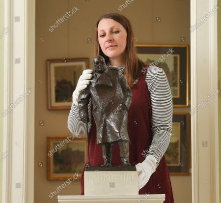 Stock Photo of Lucy Darlington from Dreweatts with the Churchill maquette.   A rare maquette of Sir Winston Churchill's famous statue in Parliament Square has sold at auction for £75,000.  The bronze model is an exact replica of the iconic sculpture which stands outside the Houses of Parliament and was one of the first 100 casts made.  Sculptor Ivor Roberts-Jones made the original maquette as a preview of the final sculpture, which was unveiled by Churchill's widow Clementine in 1973.