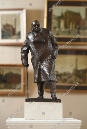 The Churchill maquette.   A rare maquette of Sir Winston Churchill's famous statue in Parliament Square has sold at auction for £75,000.  The bronze model is an exact replica of the iconic sculpture which stands outside the Houses of Parliament and was one of the first 100 casts made.  Sculptor Ivor Roberts-Jones made the original maquette as a preview of the final sculpture, which was unveiled by Churchill's widow Clementine in 1973.