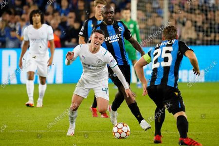 Stock Picture of Phil Foden of Manchester City takes on Ruud Vormer of Club Brugge
