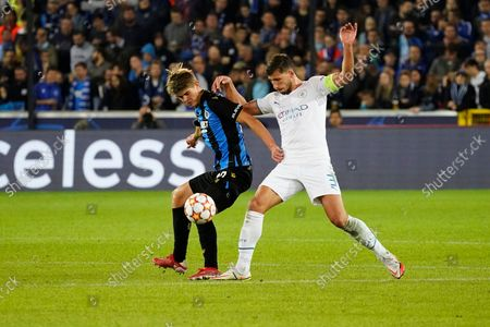 Charles De Ketelaere of Club Brugge shields the ball from Ruben Dias of Manchester City