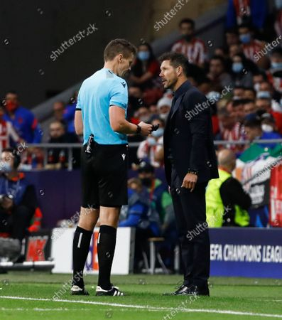 Atletico Madrid Manager Diego Simeone is spoken to by the referee