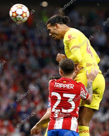 Virgil van Dijk of Liverpool heads goal wards
