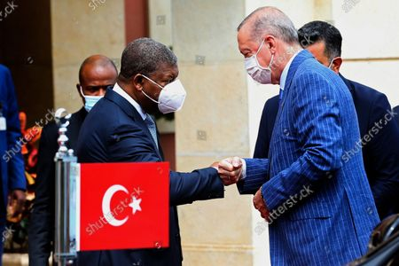 Stock Photo of Angola President Joao Lourenco (L) greets Turkish counterpart Recep Tayyip Erdogan (C) during the farewell ceremony at Presidential Palace in Luanda, Angola, 19 October 2021.