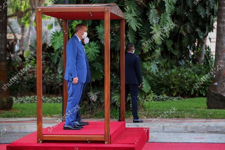 Angola President Joao Lourenco (back, covered) greets Turkish counterpart Recep Tayyip Erdogan (L) during the farewell ceremony at Presidential Palace in Luanda, Angola, 19 October 2021.