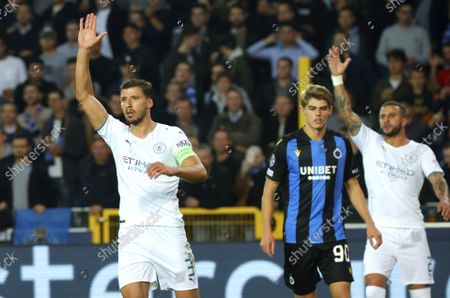 Manchester City's Ruben Dias, left, gestures during the Champions League Group A soccer match between Club Brugge and Manchester City at the Jan Breydel stadium in Bruges, Belgium
