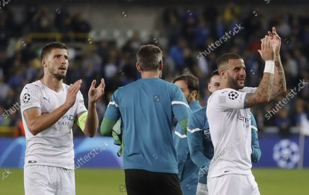 Ruben Dias (L) of Manchester City and teammate Kyle Walker (R) react after the UEFA Champions League group A soccer match between Club Brugge and Manchester City in Bruges, Belgium, 19 October 2021.