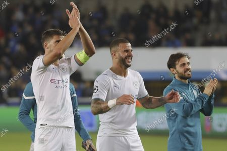 (L-R) Manchester City's Ruben Dias, Kyle Walker and Bernardo Silva  react after the UEFA Champions League group A soccer match between Club Brugge and Manchester City in Bruges, Belgium, 19 October 2021.