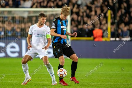 Manchester City's Ruben Dias and Club's Charles De Ketelaere fight for the ball during a game between Belgian soccer team Club Brugge and English club Manchester City, Tuesday 19 October 2021, in Brugge, Belgium, the third (out of six) in the Group A of the UEFA Champions League group stage.