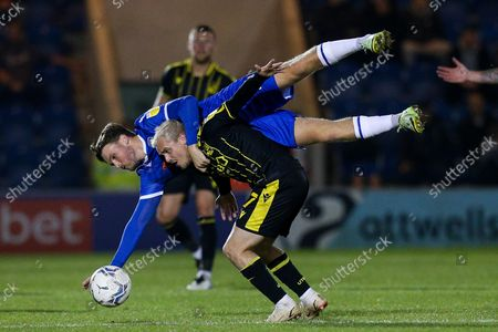 Noah Chilvers of Colchester United climbs all over Luke Thomas of Bristol Rovers