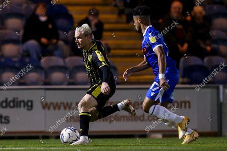 Luke Thomas of Bristol Rovers takes on Sylvester Jasper of Colchester United