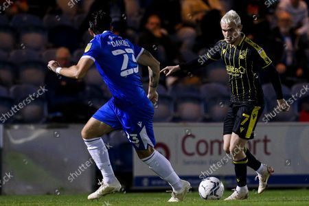 Luke Thomas of Bristol Rovers takes on Charlie Daniels of Colchester United