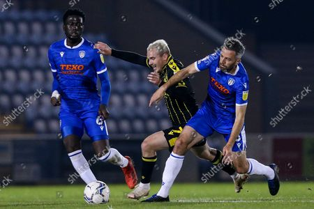 Luke Thomas of Bristol Rovers takes on Cole Skuse of Colchester United