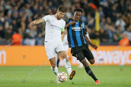 Manchester City's Ruben Dias and Club's Kamal Sowah fight for the ball during a game between Belgian soccer team Club Brugge and English club Manchester City, Tuesday 19 October 2021, in Brugge, Belgium, the third (out of six) in the Group A of the UEFA Champions League group stage.