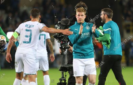 Manchester City's Ruben Dias and Manchester City's Kevin De Bruyne celebrate after winning a game between Belgian soccer team Club Brugge and English club Manchester City, Tuesday 19 October 2021, in Brugge, Belgium, the third (out of six) in the Group A of the UEFA Champions League group stage.