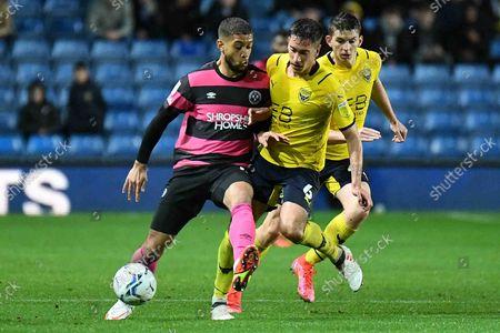 Oxford United midfielder Alex Rodriguez Gorrin (6) battles for possession  with Shrewsbury Town forward Rekeil Pike (15) during the EFL Sky Bet League 1 match between Oxford United and Shrewsbury Town at the Kassam Stadium, Oxford