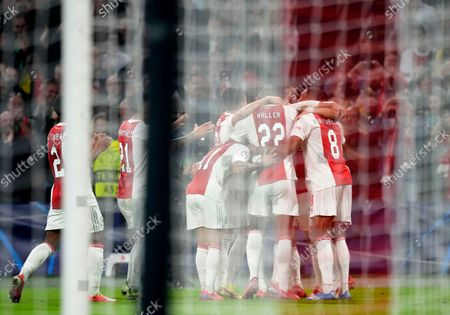 Ajax's Daley Blind celebrates with teammates after scoring his side's second goal during the Champions League group C soccer match between Ajax and Borussia Dortmund at the Johan Cruyff ArenA in Amsterdam, Netherlands