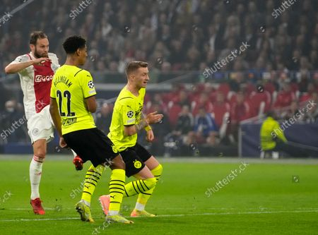 Ajax's Daley Blind, left, scores his side's second goal during the Champions League group C soccer match between Ajax and Borussia Dortmund at the Johan Cruyff ArenA in Amsterdam, Netherlands