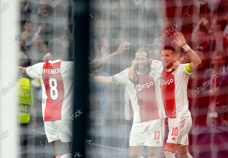Ajax's Daley Blind, center, celebrates with teammates after scoring his side's second goal during the Champions League group C soccer match between Ajax and Borussia Dortmund at the Johan Cruyff ArenA in Amsterdam, Netherlands