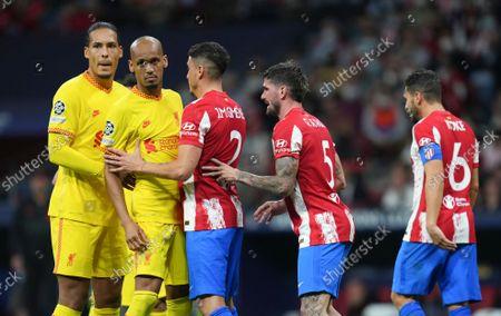 Virgil van Dijk and Fabinho of Liverpool go up for a corner