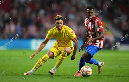 Alex Oxlade-Chamberlain of Liverpool and Thomas Lemar of Atletico Madrid