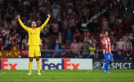 Virgil van Dijk of Liverpool celebrates at full time next to Luis Suárez of Atletico Madrid