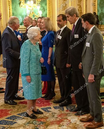 Britain's Queen Elizabeth II greets United States Special Presidential Envoy for Climate, John Kerry, second right, at a reception for the Global Investment Summit in Windsor Castle, Windsor, England