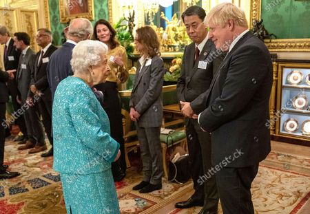 Britain's Queen Elizabeth II talks with Britain's Prime Minister Boris Johnson, right, at a reception for the Global Investment Summit in Windsor Castle, Windsor, England