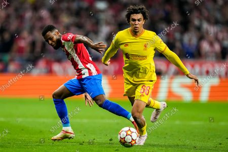 Liverpool's Trent Alexander-Arnold, right, duels for the ball with Atletico Madrid's Thomas Lemar during the Champions League Group B soccer match between Atletico Madrid and Liverpool at Wanda Metropolitano stadium in Madrid, Spain