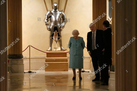 Britain's Queen Elizabeth II and Prime Minister Boris Johnson arrive to greet guests at a reception for the Global Investment Summit in Windsor Castle, Windsor, England, Tuesday, Oct. 19, 2021.