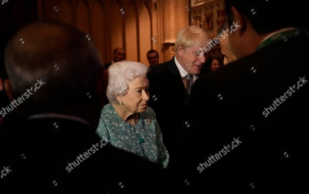 Britain's Queen Elizabeth II and Prime Minister Boris Johnson greet guests at a reception for the Global Investment Summit in Windsor Castle, Windsor, England, Tuesday, Oct. 19, 2021.