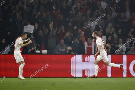 (lr) Dusan Tadic of Ajax, Daley Blind or Ajax celebrate the 2-0 during the UEFA Champions League match between Ajax Amsterdam and Borussia Dortmund at the Johan Cruijff arena on October 19, 2021 in Amsterdam, Netherlands.