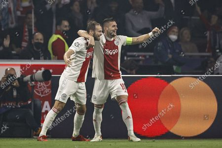 §(lr) Daley Blind of Ajax, Dusan Tadic or Ajax celebrate 2-0 during the UEFA Champions League match between Ajax Amsterdam and Borussia Dortmund at the Johan Cruijff arena on October 19, 2021 in Amsterdam, Netherlands.
