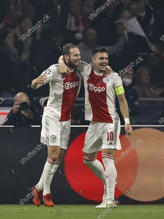 (lr) Daley Blind of Ajax, Dusan Tadic or Ajax celebrate 2-0 during the UEFA Champions League match between Ajax Amsterdam and Borussia Dortmund at the Johan Cruijff arena on October 19, 2021 in Amsterdam, Netherlands.