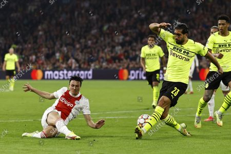 (lr) Steven Berghuis or Ajax, Emre Can or Borussia Dortmund Jude Bellingham or Borussia Dortmund during the UEFA Champions League match between Ajax Amsterdam and Borussia Dortmund at the Johan Cruijff arena on October 19, 2021 in Amsterdam, Netherlands.