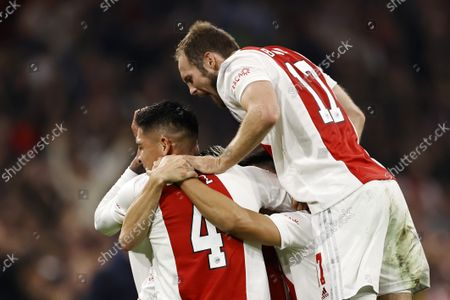 (lr) Edson Alvarez or Ajax, Antony Matheus Dos Santos or Ajax, Lisandro Martinez or Ajax, Daley Blind or Ajax celebrate the 3-0 during the UEFA Champions League match between Ajax Amsterdam and Borussia Dortmund in the Johan Cruijff arena on 19 October 2021 in Amsterdam, Netherlands.