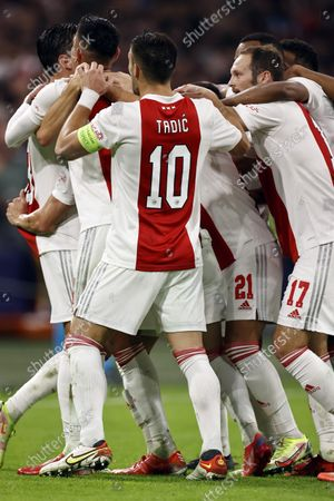 (lr) Steven Berghuis or Ajax, Edson Alvarez or Ajax, Dusan Tadic of Ajax, Daley Blind or Ajax celebrate the 3-0 during the UEFA Champions League match between Ajax Amsterdam and Borussia Dortmund in the Johan Cruijff arena on October 19, 2021 in Amsterdam, the Netherlands.