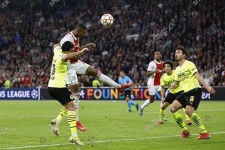 (lr) Emre Can of Borussia Dortmund, Sebastien Haller of Ajax scores the 4-0, Mats Hummels of Borussia Dortmund during the UEFA Champions League match between Ajax Amsterdam and Borussia Dortmund at the Johan Cruijff arena on October 19, 2021 in Amsterdam, The Netherlands.