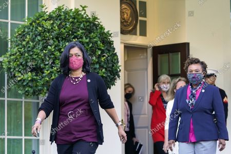 Rep. Pramila Jayapal, D-Wash., the chair of the Congressional Progressive Caucus, left, and Rep. Barbara Lee, D-Calif., right, and other lawmakers, walk out of the West Wing of the White House in Washington, to talk with reporters following their meeting with President Joe Biden