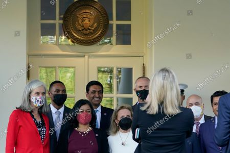 Members of the Congressional Progressive Caucus, from left, Katherine Clark, D-Mass., Rep. Ritchie Torres, D-N.Y., Rep. Pramila Jayapal, D-Wash., Rep. Ro Khanna, D-Calif., Rep. Debbie Dingell, D-Mich., Rep. Jared Huffman, D-Calif., Rep. Mark Pocan, D-Wis., and Rep. Jimmy Gomez, D-Calif., pose for a photo outside the West Wing of the White House in Washington, following their meeting with President Joe Biden