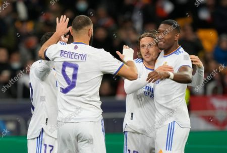 Left to right: Real Madrid's Lucas Vazquez, Karim Benzema, Luka Modric and David Alaba celebrate after scoring their side's second goal during the Champions League group D soccer match between Shakhtar Donetsk and Real Madrid at the Olympiyskiy stadium in Kyiv, Ukraine