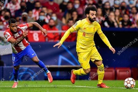 Thomas Lemar of Club Atletico de Madrid and Mohamed Salah of Liverpool