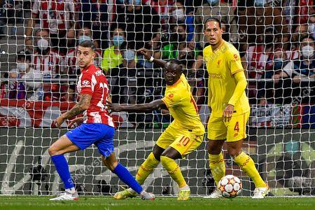 Mario Hermoso of Club Atletico de Madrid, Sadio Mane of Liverpool FC and Virgil van Dijk of Liverpool FC
