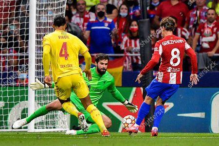 Virgil van Dijk of Liverpool FC, Alisson of Liverpool FC and Antoine Griezmann of Club Atletico de Madrid