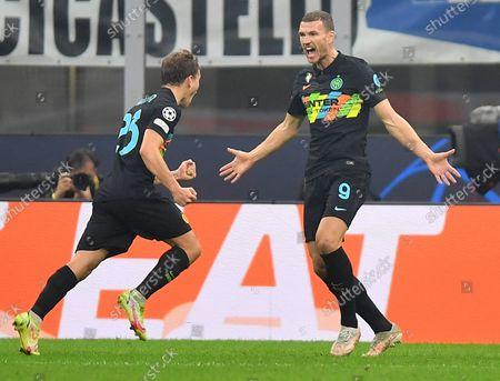 (211020) - MILAN, Oct. 20, 2021 (Xinhua) - FC Inter's Edin Dzeko (R) celebrates his goal during the UEFA Champions League Group D match between FC Inter and FC Sheriff Tiraspol in Milan, Italy, Oct. 19, 2021.