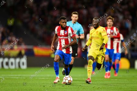 Thomas Lemar and Naby Keita during UEFA Champions League match between Atletico de Madrid and Liverpool FC at Wanda Metropolitano on October 19, 2021 in Madrid, Spain.