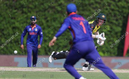 Australia's David Warner bats during the Cricket Twenty20 World Cup warm-up match between India and Australia in Dubai, UAE