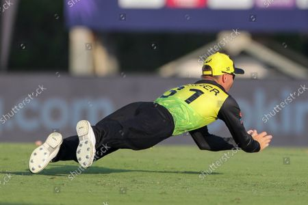 Australia's David Warner takes a catch to dismiss India's KL Rahul during the Cricket Twenty20 World Cup warm-up match between India and Australia in Dubai, UAE