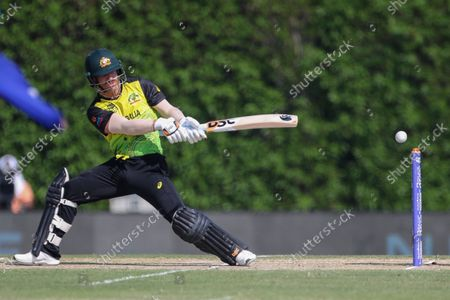 Australia's David Warner plays and misses at the ball to be out LBW for one run during the Cricket Twenty20 World Cup warm-up match between India and Australia in Dubai, UAE